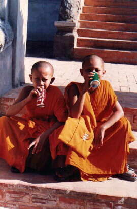 Young Monks Getting A Taste Of The West